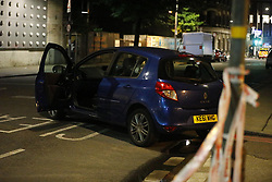 © Licensed to London News Pictures. 03/06/2017. London, UK. People leave the scene after a terrorist incident involving a vehicle and pedestrians in London Bridge.  Reports are saying a white transit van may have deliberately run down people crossing the bridge. Photo credit: Tolga Akmen/LNP