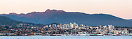 North Vancouver and Burrard Inlet in the early evening after during sunset which casts a glow on Mount Seymour. Photographed from Brockton Point at Stanley Park in Vancouver, British Columbia, Canada.