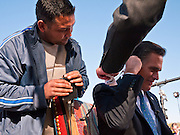 06 DECEMBER 2011 - PARADISE VALLEY, AZ: Mitt Romney is wired for sound before an interview with FOX News Tuesday at Hermosa Inn. Former Vice President Dan Quayle endorsed Republic Presidential hopeful Mitt Romney at the Hermosa Inn in Paradise Valley Tuesday.    PHOTO BY JACK KURTZ