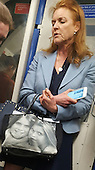 Exclusive Duchess of York pictured on the Tube asleep