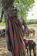 Africa, Ethiopia, Debub Omo Zone, Mursi tribesman. A nomadic cattle herder ethnic group located in Southern Ethiopia, close to the Sudanese border. A warrior