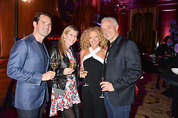 "Left to right, JIMMY CARR, KAROLINE COPPING, KELLY HOPPEN and JOHN GARDINER at the presentation of Le Prix Champagne De La Joie de Vivre to Stephen Webster in celebration of his long standing contribution to ""Joie de Vivre' held at the Council Room, One Great George Street, London on 22nd April 2015."