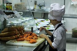 October 7, 2018 - Gaza City, The Gaza Strip, Palestine - Mahmoud preparing food at Organo restaurant kitchen in Gaza city, Mahmoud Khader Abu Nada, a 11 years old Palestinian kid from Beach refugee camp west of Gaza city, Mahmoud a Cancer patient and preparing food his passion  (Credit Image: © Mahmoud Khattab/Quds Net News via ZUMA Wire)
