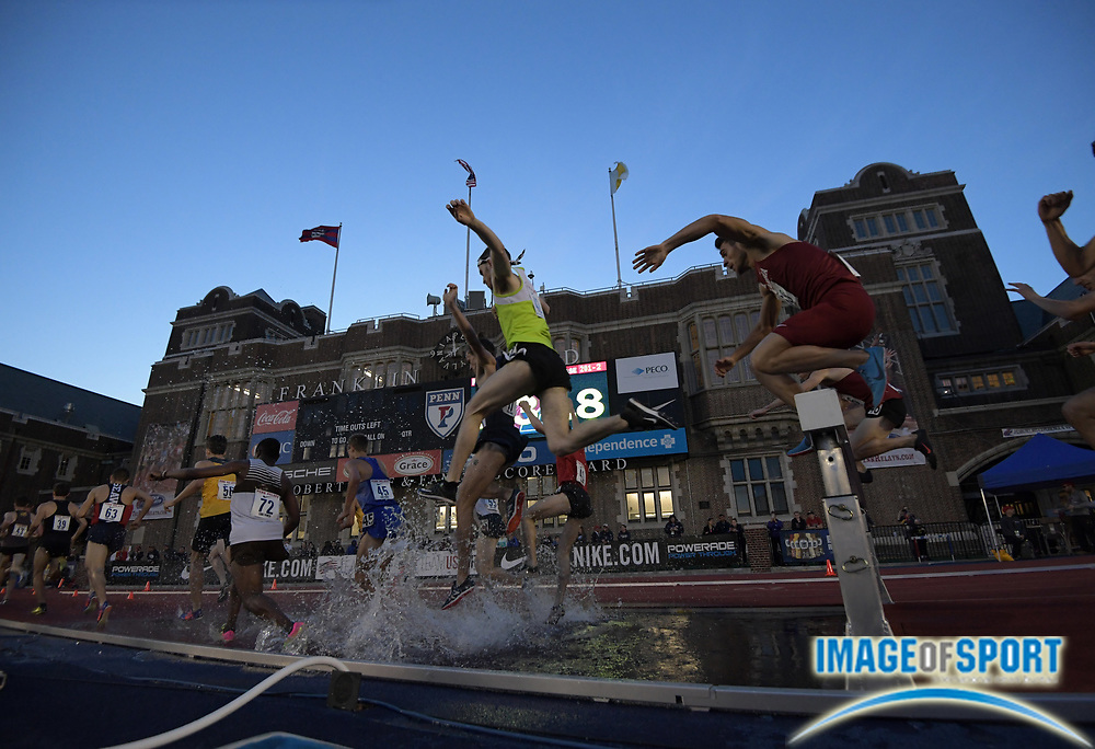 Apr 26, 2018; Philadelphia, PA, USA; Runners race over the water jump in the steeplechase during the 124th Penn Relays at Franklin Field.