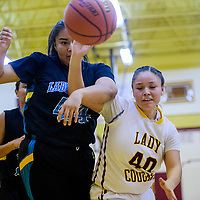 Tohatchi Cougar Samantha Belae (40) and Navajo Prep Eagle Savannah Anderson (44) compete for rebound Thursday at Tohatchi High School.