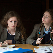 """Pupils attend a classics class at Rugby School in central England, March 18, 2015.  The public school, founded in 1567 was amongst the first """"Public"""" schools in England. The school is known as the home of rugby. Local legend  states that in 1823 pupil William Webb Ellis first ran with the ball inventing the game of rugby football which took its name from the school. In 2015 20 countries will compete in the Rugby World Cup which is hosted by England REUTERS/Neil Hall"""