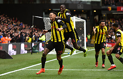 Watford's Etienne Capoue (left) celebrates scoring his sides first goal of the game with teammate Abdoulaye Doucoure