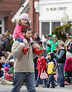 Goshen, New York - A man carries a young girl on his shoulders while marching in the mid-Hudson St. Patrick's Day parade on March 13, 2011. ©Tom Bushey / The Image Works