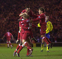 Photo. Glyn Thomas.<br /> Middlesbrough v Arsenal. Carling Cup semi final second leg. <br /> Riverside Stadium, Middlesbrough. 03/02/2004.<br /> Boro's Stuart Parnaby is mobbed by teammates after scoring his side's second goal of the evening.