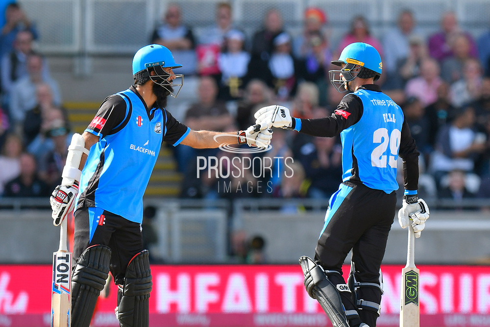 Moeen Ali of Worcestershire and Tom Fell of Worcestershire touch gloves during the Vitality T20 Finals Day Semi Final 2018 match between Worcestershire Rapids and Lancashire Lightning at Edgbaston, Birmingham, United Kingdom on 15 September 2018.