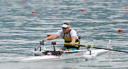 Bled, SLOVENIA, Adaptive Rowing,  AUS ASM1X, Benjamin HOULISON, move's away from the start in his heat,  FISA World Cup, Bled venue, Lake Bled.  Friday  28/05/2010  [Mandatory Credit Peter Spurrier .  Adaptive, Rowing. Para Rowing,