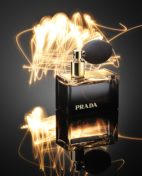 Bottle of perfume L'eau Ambree Prada - scent described by lines painted with light.