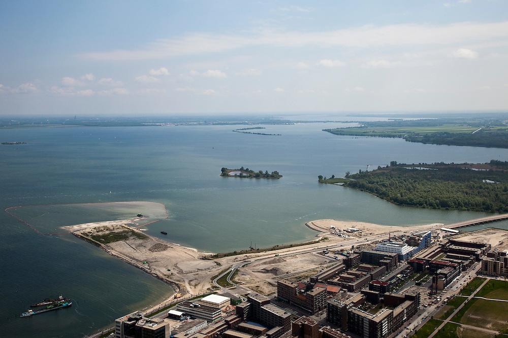 Nederland, Amsterdam, IJburg, 25-05-2010. Haveneiland met strand Blijburg, IJmeer met links Pampus, gezien naar Almere (aan de horizon). Er zijn plannen om Almere verder uit te breiden en in het IJmeer te gaan bouwen. Ook aanleg van een IJmeerverbinding (IJmeerbrug) wordt overwogen..Harbour Island with beach Blijburg, IJmeer with Pampusm(l), Almere on the horizon. IJmeer (IJsselmeer) seen to Almere (at the horizon). There are plans to further expand Almere in the IJmeer. Also the construction of a 'IJ-connexion' (bridge) is considered..luchtfoto (toeslag), aerial photo (additional fee required).foto/photo Siebe Swart