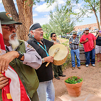 082715  Adron Gardner/Independent<br /> <br /> Julius Smith, left, stands at attention with the American flag as William Yazzie sings the Flag Song written by Navajo Code Talker Teddy Draper during the grand opening of  the Hubbell Trading Post visitor's center, newly furnished with historical exhibits.
