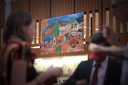 """1 December 2017, Geneva, Switzerland: On World AIDS Day 2017, the World Council of Churches – Ecumenical Advocacy Alliance (WCC-EAA) brought together representatives of faith-based organizations as well as public sector and inter-governmental organizations at the Ecumenical Centre in Geneva on 1 December. The event saw a commemorative prayer service, an interactive art exhibition, and a round table discussion on how to improve access to testing and treatment for children and adolescents living with HIV, particularly by means of education. """"Painting for an Education"""" brought to the event an interactive exhibition, """"Kisumu - Nairobi - Geneva - art from them to us"""", featuring paintings and artwork from HIV positive children and adolescents in Kenya. """"Through works of art, we are able to strengthen the confidence of young people living with HIV, and encourage them to find ways to share their stories,"""" explained Gelise McCullough, the initiator of the exhibition. """"Children and adolescents face a lot of stigma relating to HIV, and we need to hear their stories, and help them get access to education, with all that this means by way of affording the books, uniforms, meals, etc. But ultimately, education is not only vital in itself, but can help young people living with HIV make healthier life choices, for example by adhering to treatment, and it can also offer opportunities to improve their livelihoods, and strengthen their health-seeking behaviour. But if we all do a little, together we can achieve a lot,"""" McCullough said. Through an interactive workshop, children and adolescents were invited to contribute by producing awork of art of their own. The art was sold, to gather money for school and lunch fees for children living with HIV in Kenya."""