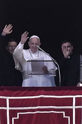 Vatican, Rome - May 12, 2019.Pope Francis gives his blessing during the Regina Caeli Prayer flanked by two newly ordained priests from the window of his study overlooking St Peter's Square at the Vatican after celebrating a priesthood ordination and mass in St Peter's Basilica on May 12, 2019 (Credit Image: © Maria Grazia Picciarella/Ropi via ZUMA Press)