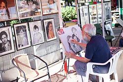 THEMENBILD - URLAUB IN KROATIEN, ein Portraitmaler, Künstler bei der Arbeit, aufgenommen am 01.07.2014 in Porec, Kroatien // a portrait painter, artist at work in Porec, Croatia on 2014/07/01. EXPA Pictures © 2014, PhotoCredit: EXPA/ JFK