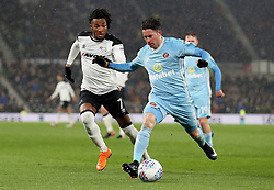 Derby County's Kasey Palmer (left) and Sunderland's Bryan Oviedo battle for the ball