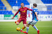 Tom Aldred (#5) of Motherwell FC gets to the ball ahead of Matthew Kennedy (#33) of St Johnstone FC during the Ladbrokes Scottish Premiership match between St Johnstone and Motherwell at McDiarmid Stadium, Perth, Scotland on 11 May 2019.