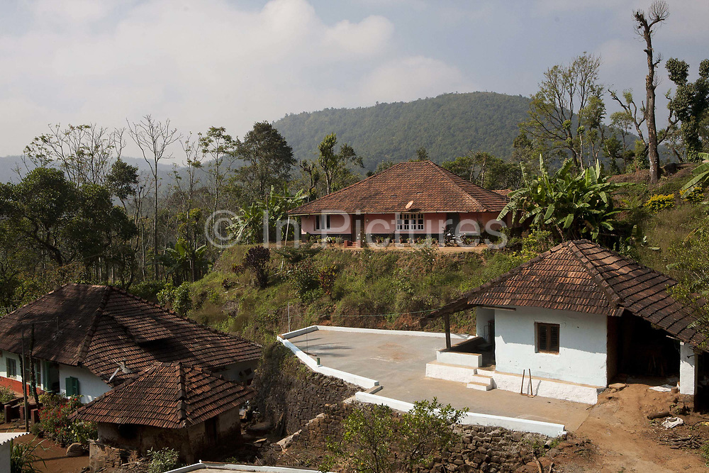 Coffee farm / buldings in the hills. Coorg or Kadagu is the largest coffee growing region of India, in the state of Karnataka, the inhabitants - the Kodavas have been cultivating crops such as coffee, black pepper and cardamon for many generations.
