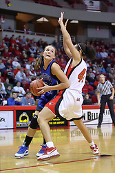 01 January 2009: Megan Neuvirth works her way past Ashleen Bracey to get in the lane. The game between the Creighton Bluejays and the Illinois State Redbirds ended with the Redbirds on top by a score of 63-43 on Doug Collins Court inside Redbird Arena on the campus of Illinois State University, Normal IL.