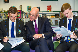 Pictured: Mr Swinney checks Callum Brown's results and Alistair Hampton is focused on his results.<br /> <br /> <br /> Education Secretary  John Swinney visited Firrhill School today and met students and parents as the results were available for opening.<br /> <br /> <br /> Ger Harley | EEm 7 August 2018