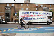 Removal van working near to council flats on Cable Street in Tower Hamlets, East London. Many people are at risk of losing their homes in London with the introduction of new benefit rules, which may push many people renting or who own council apartments out of the city.