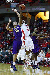 19 November 2011:  Tyler Brown gets inside and attempts a shot that Justin Glenn aims to stop during an NCAA mens basketball game between the Lipscomb Bison and the Illinois State Redbirds in Redbird Arena, Normal IL