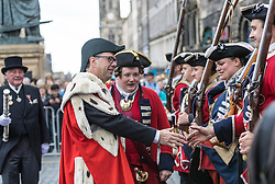 Edinburgh Riding of the Marches commemorates the return in 1513 of Randolph Murray clasping the Ancient Blue Blanket Banner with the tragic news of the defeat of the Scottish Army at the Battle of Flodden. 280 Horses traverse the boundaries of Edinburgh before culminating in a procession along the Royal Mile culminating in a ceremony celebrating the return of the flag at the historic Mercat Cross.<br /> <br /> Pictured: Lord Provost of Edinburgh, Donald Wilson with members of the Edinburgh City Guard