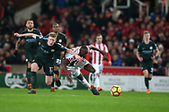 Bruno Martins Indi of Stoke City ® holds off Kevin De Bruyne of Manchester City. Premier league match, Stoke City v Manchester City at the Bet365 Stadium in Stoke on Trent, Staffs on Monday 12th March 2018.<br /> pic by Andrew Orchard, Andrew Orchard sports photography.