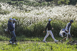October 22, 2017 - Seogwipo, Jeju Island, South Korea - October 22, 2017-Seogwipo, Jeju Island, South Korea-(From left) Morgan Hoffmann and Jason Day moving after tee up on the 1th green during an PGA TOUR CJ CUP NINE BRIDGE DAY 4 at Nine Bridge CC in Jeju Island, South Korea. (Credit Image: © Ryu Seung Il via ZUMA Wire)