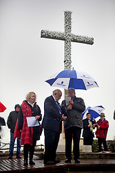 11 November 2018. Lochnagar Crater, La Boisselle, Somme, France. <br /> <br /> Richard Dunning MBE (centre - event organiser and owner of the land) observes a minute's silence. Gathered in the pouring rain, those who perished in the Great War are remembered by British and French civilians on the 100th anniversary of the Great War. <br /> <br /> Lochnagar Crater was created by the Tunnelling Companies of the Royal Engineers under a German field fortification. The explosion was the loudest man made noise created at that time, purportedly heard in London. <br /> <br /> Photo©; Charlie Varley/varleypix.com