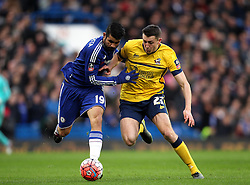 Diego Costa of Chelsea takes on Murray Wallace of Scunthorpe United - Mandatory byline: Robbie Stephenson/JMP - 10/01/2016 - FOOTBALL - Stamford Bridge - London, England - Chelsea v Scunthrope United - FA Cup Third Round