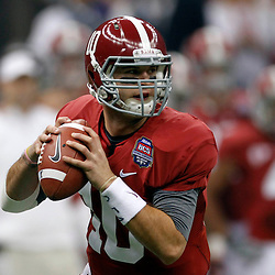 Jan 9, 2012; New Orleans, LA, USA; Alabama Crimson Tide quarterback A.J. McCarron (10) rolls out to pass against the LSU Tigers during the first half of the 2012 BCS National Championship game at the Mercedes-Benz Superdome.  Mandatory Credit: Derick E. Hingle-US PRESSWIRE