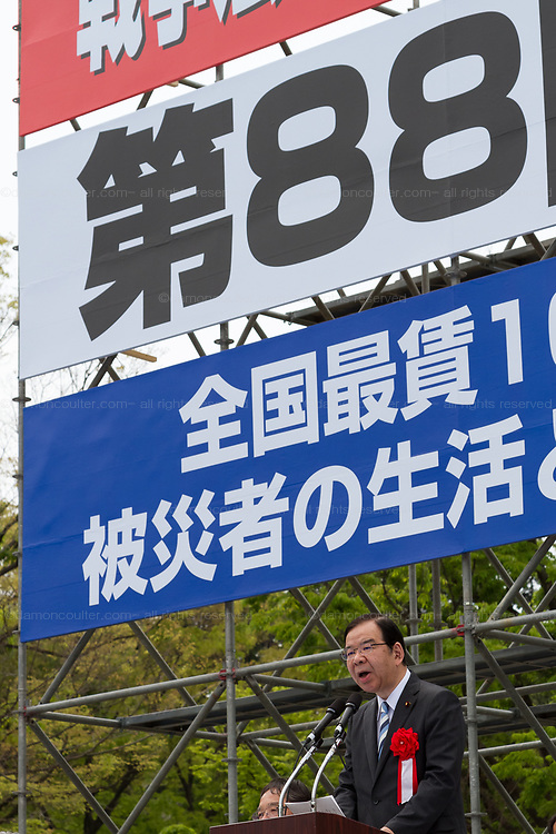Leader of the Japanese Communist party, Shii Kazuo talks to  thousands of people in the 88th May Day rally in Central Tokyo to mark International Workers` Day. Tokyo, Japan. Monday, May 1st 2017 The rally started at 9am in Yoyogi Park near Shibuya and the march began at 12:30 despite heavy rain and thunderstorms. The rally called for an end to overwork in Japan along with other labour issues and  protested traditional left wing subjects such as nuclear power and weapons, and Prime Minister Shinzo Abe's plans to reinterpret  Article 9 of the Japanese constitution, thus making the Japanese military Self Defence Force able to fight wars alongside its allies.