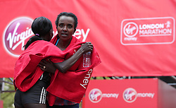 Winner Kenya's Mary Keitany (left) and Ethiopia's Tirunesh Dibaba after the Women's Virgin Money London Marathon, London. PRESS ASSOCIATION. Picture date: Sunday April 23, 2017. See PA story ATHLETICS Marathon. Photo credit should read: Yui Mok/PA Wire
