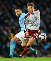 Jeff Hendrick of Burnley and Nicolas Otamendi of Manchester City - Mandatory by-line: Matt McNulty/JMP - 06/01/2018 - FOOTBALL - Etihad Stadium - Manchester, England - Manchester City v Burnley - Emirates FA Cup Third Round