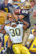 The University of Notre Dame's Matt Shelton hauls in a touchdown pass over the arms of Michigan's Marcus Curry.