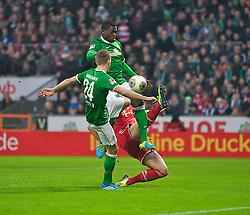 07.12.2013, Weserstadion, Bremen, GER, 1. FBL, SV Werder Bremen vs FC Bayern Muenchen, 15. Runde, im Bild Daniel van Buyten (FC Bayern Muenchen / München #5) verteidigt gegen Assani Lukimya (Bremen #5), Nils Petersen (Bremen #24) // Daniel van Buyten (FC Bayern Muenchen / München #5) verteidigt gegen Assani Lukimya (Bremen #5), Nils Petersen (Bremen #24) during the German Bundesliga 15th round match between SV Werder Bremen and FC Bayern Munich at the Weserstadion in Bremen, Germany on 2013/12/08. EXPA Pictures © 2013, PhotoCredit: EXPA/ Andreas Gumz<br /> <br /> *****ATTENTION - OUT of GER*****