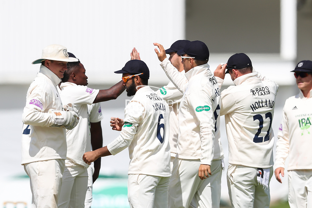 Wicket! Fidel Edwards of Hampshire celebrates after taking the wicket of Harry Brook of Yorkshire during the opening day of the Specsavers County Champ Div 1 match between Yorkshire County Cricket Club and Hampshire County Cricket Club at Headingley Stadium, Headingley, United Kingdom on 27 May 2019.