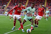 Football - 2020 / 2021 Sky Bet Championship - Play-offs - Semi-final 1st Leg - Barnsley vs Swansea City - Oakwell<br /> <br /> Jamal Lowe of Swansea City and Toby Sibbick of Barnsley
