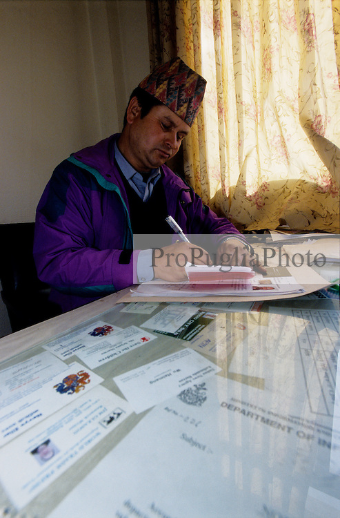 Kathmandu, 16 February 2005. An officer from the Ministry of Information and Communication is issuing a press pass to a foreign journalist. The accreditation is valid within Kathmandu Valley only. The government has said that the media should publish information on the insurgency provided by the security forces only or face punishment