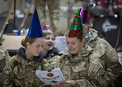 **UDATED CAPTION** 31/12/2013. Members of the Armed Forces welcomed in the final year of operations in CAmp Bastion, Afghanistan this evening. Service men and women were entertained by a choir from the military hospital and a live band from the 3 Royal Horse Artillery. Photo credit: Alison Baskerville/LNP