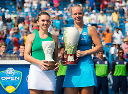 August 19, 2018 - Simona Halep of Romania & Kiki Bertens of the Netherlands pose with their trophies after the final of the 2018 Western & Southern Open WTA Premier 5 tennis tournament. Cincinnati, Ohio, USA. August 19th 2018. (Credit Image: © AFP7 via ZUMA Wire)