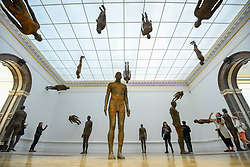 "© Licensed to London News Pictures. 17/09/2019. LONDON, UK. Visitors view ""Lost Horizon I"", 2008, by Antony Gormley, which comprises 24 cast iron body forms. Preview of a new exhibition by Antony Gormley at the Royal Academy of Arts.  The show bring together existing and specially conceived new works from drawing to sculptures to experimental environments to be displayed in all 13 rooms of the RA's Main Galleries 21 September to 3 December 2019.  Photo credit: Stephen Chung/LNP"