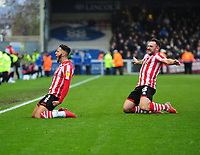 Lincoln City's Kellan Gordon celebrates scoring the opening goal with with team-mate Neal Eardley<br /> <br /> Photographer Andrew Vaughan/CameraSport<br /> <br /> The EFL Sky Bet League Two - Lincoln City v Mansfield Town - Saturday 24th November 2018 - Sincil Bank - Lincoln<br /> <br /> World Copyright © 2018 CameraSport. All rights reserved. 43 Linden Ave. Countesthorpe. Leicester. England. LE8 5PG - Tel: +44 (0) 116 277 4147 - admin@camerasport.com - www.camerasport.com