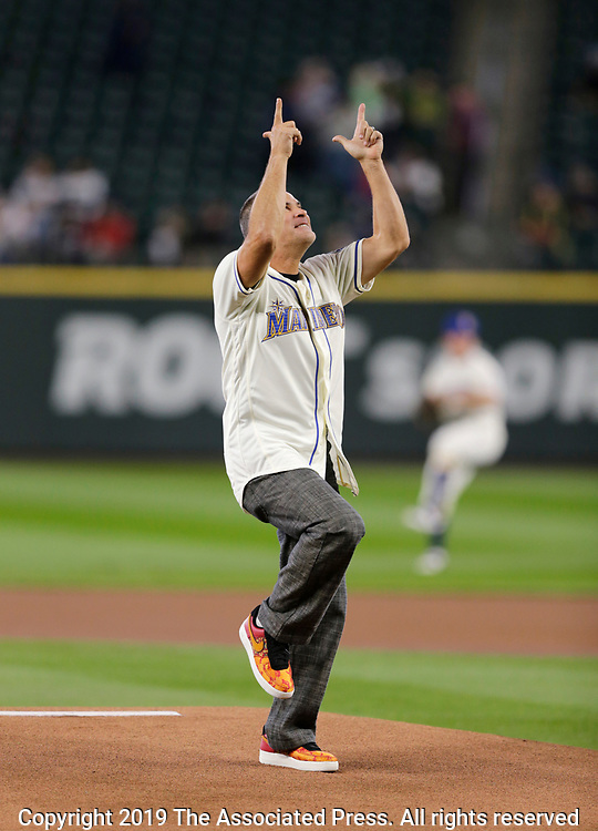 Retired MLB player Omar Vizquel on the mound after throwing the ceremonial first pitch before a baseball game between the Seattle Mariners and the Chicago White Sox, Sunday, Sept. 15, 2019, in Seattle. (AP Photo/John Froschauer)