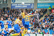 Chesterfield goalkeeper Aaron Ramsdale (1) punches this one clear during the EFL Sky Bet League 2 match between Chesterfield and Mansfield Town at the Proact stadium, Chesterfield, England on 14 A pril 2018. Picture by Nigel Cole.