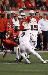 25 October 2014: Dontae McCoy gets past John Edwards for a shot at runner Julian Burton during an NCAA Missouri Valley Conference game between the Missouri State Bears and the Illinois State Redbirds at Hancock Stadium in Normal, Illinois.