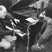 John Williams,  prolific composer of movie scores, conductor of The Boston Pops, being interviewed by Gene Shallit for NBC news.